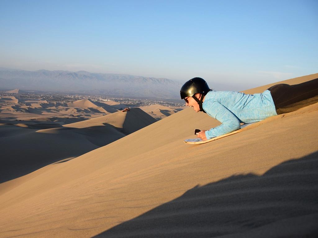 adventure travel - sand boarding